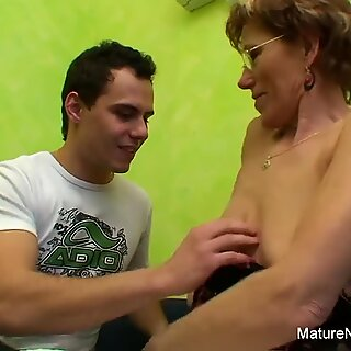 Granny watches porn before getting fucked by a younger guy