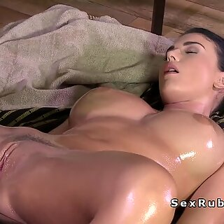 Oiled busty lesbian gets massaged