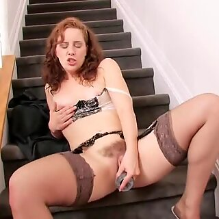 Stiff toy fits in her hairy pussy