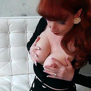 Horny redhead mature Red XXX fucks her big black dildo