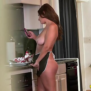 Milf with a big onion in the kitchen