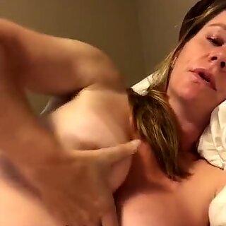 Hot busty mama masturbating on bed
