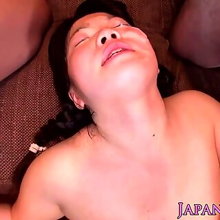 Cute Asian makes her natural pussy soaking wet Report this video